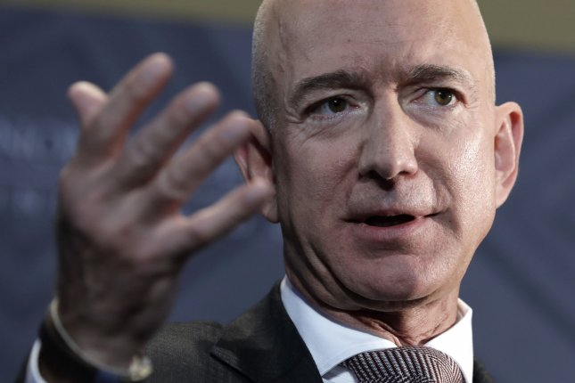 Amazon founder and CEO Jeff Bezos challenged other retail chains to raise their minimum hourly wage to $15. File Photo by Yuri Gripas/UPI