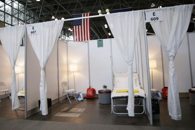 Newly erected hospital rooms sectioned off with white curtains are on display after Gov. Andrew Cuomo speaks with the New York National Guard on site at the Jacob K. Javits Convention Center in New York City on March 27. The Javits Center is one of dozens of sites targeted to be turned into temporary care centers amid the coronavirus pandemic. Photo by John Angelillo/UPI