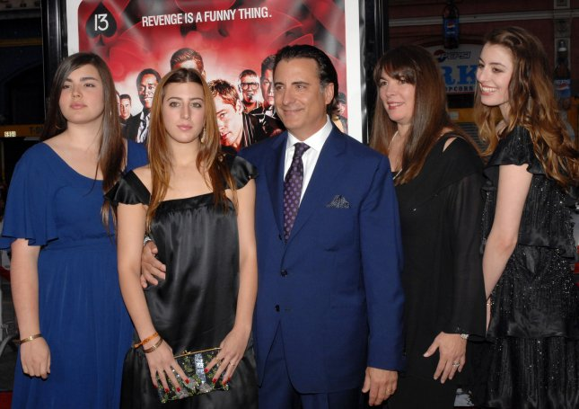Andy Garcia (3rd-L)), a cast member in the motion picture comedy thriller Ocean's Thirteen, arrives with his wife Marivi Lorido (4th-L) and their daughters Alessandra (L) Daniella (2nd-L) and Dominik for the premiere of the film at Grauman's Chinese Theatre in Los Angeles on June 5, 2007. (UPI Photo/Jim Ruymen)