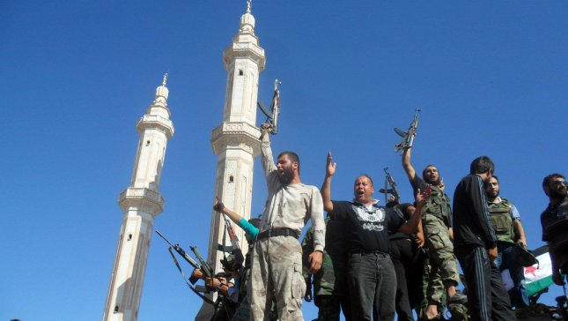 Members of the Free Syrian Army chant slogans against Syrian President Bashar al-Assad in Aleppo, Syria on July 19, 2012. UPI/Khaled Tallawy