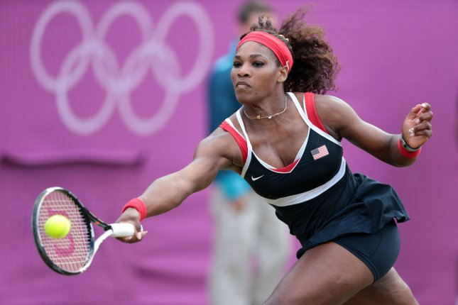 America's Serena Williams in action against Poland's Caroline Wozniacki in the Women's Tennis Quarter-Final at the London 2012 Summer Olympics on August 02, 2012 in Wimbledon, London. UPI/Hugo Philpott