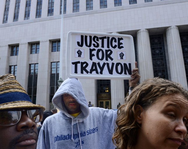 Hundreds of protesters participate in a Justice for Trayvon rally at the federal courthouse in downtown Los Angeles on July 20, 2013. The demonstration was part of a 100-city effort to demand a federal investigation into possible violations of Travyon Martin's civil rights. A jury in Sanford, Florida last Saturday found George Zimmerman, a volunteer neighborhood watchman, not guilty of shooting Martin dead, a 17 year-old unarmed teen on the night of February 26, 2012. UPI/Jim Ruymen