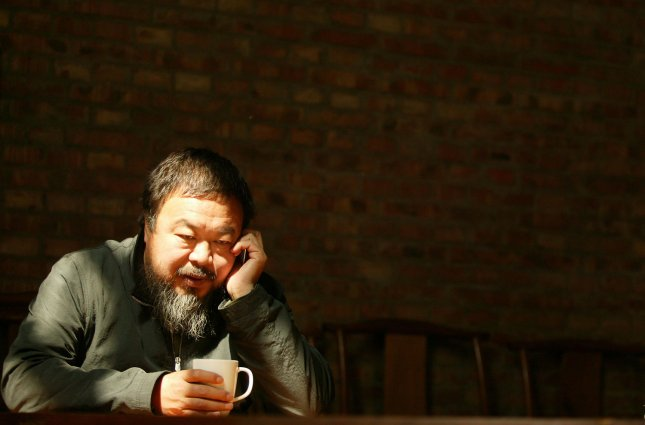 Ai Weiwei, 53, one of China's most prominent avant-garde artists and human rights activists, poses for a portrait in his Beijing studio on April 25, 2009. U.S. Secretary of State Hillary Clinton urged China to free dozens of government critics rounded up this year including Ai Weiwei and said Beijing's human rights record was worsening. UPI/Stephen Shaver