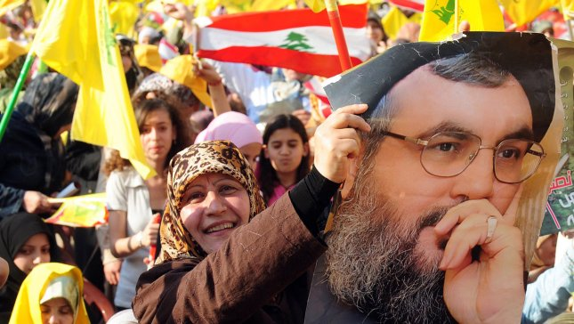Lebanese Moslem Shiite women carry posters of Hezbollah leader Hassan Nasrallah. Nasrallah said Syrians are faced with two choices, either dialogue and elections or the current (Iraq-like) model. (UPI Photo)
