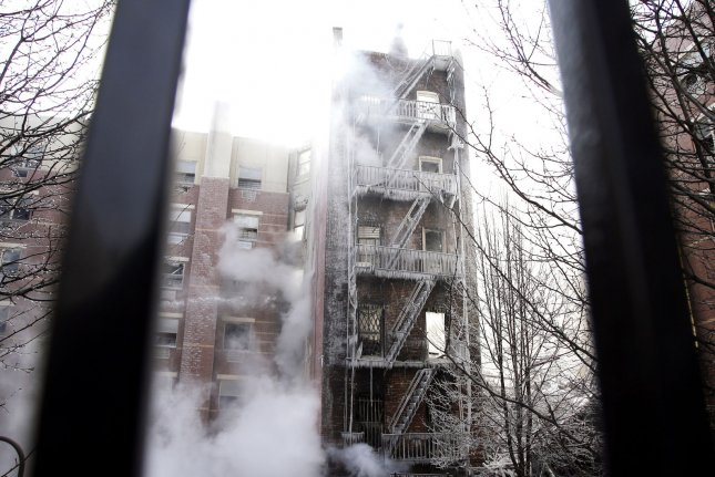 Icicles form on the fire escape at the smoky scene of 2 collapsed buildings at 116th St and Park Avenue in New York City on March 13, 2014. At least 7 people were killed and several others injured when a gas leak caused an explosion that leveled two Manhattan buildings on March 12, 2014. UPI/John Angelillo