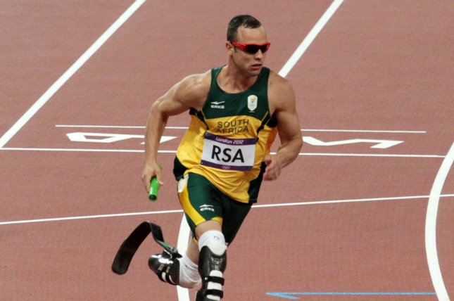 Oscar Pistorius, shown competing at the London 2012 Summer Olympics on August 10, 2012, was arrested and charged with the murder of his girlfriend model Reeva Steenkamp, on February 14, 2013 in Pretoria, South Africa. (UPI/Hugo Philpott)