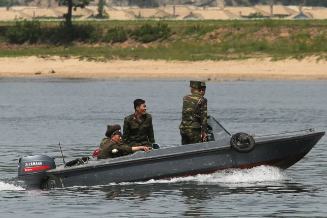 North Korean soldiers patrol the banks of the Yalu River near Sinuiju, across the Yalu River from Dandong, China's largest border city with North Korea. Pyongyang said Friday the United States has threatened our people for more than half a century with nuclear weapons. Photo by Stephen Shaver/UPI