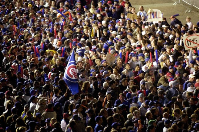 Chicago Cubs fans gather outside of Wrigley Field in Chicago, Il., for Game 6 of the NLCS on October 14, 2003. The cubs led the series 3-2, and led 3-0 in the 8th inning before a fan reached out and prevented Moises Alou from catching a foul ball for an out, opening the door on an eight-run rally and then a Game 7 loss. Photo by Mark Cowan/UPI