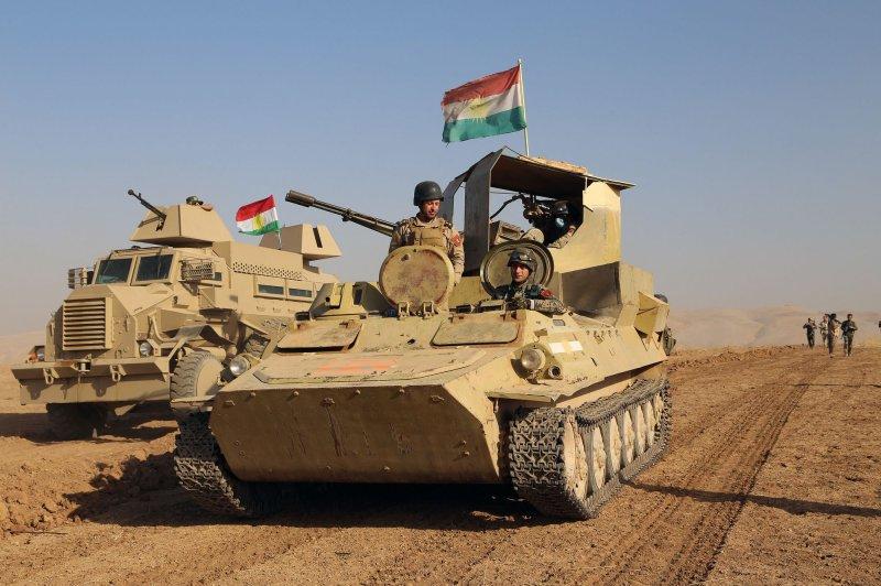 Tanks of Iraqi Kurdish peshmerga forces take positions as they attack Islamic State Militants(Daesh) north of Mosul, Iraq on October 20, 2016. Photo by Shvan Harki/UPI