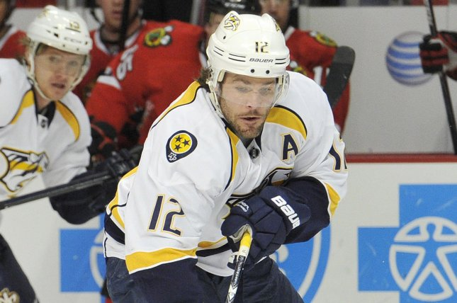 Nashville Predators center Mike Fisher passes the puck during the first period against the Chicago Blackhawks at the United Center. File photo by Brian Kersey/UPI