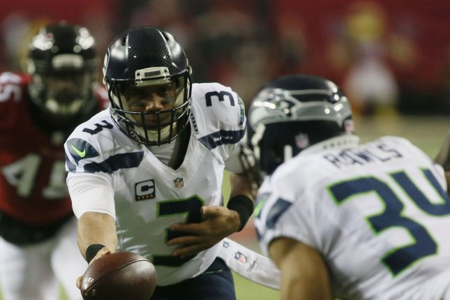 Seattle Seahawks quarterback Russell Wilson hands off to Thomas Rawls during first quarter action against the Atlanta Falcons in their NFC playoff game at the Georgia Dome in Atlanta on January 14, 2017. File photo by Phil Skinner/UPI