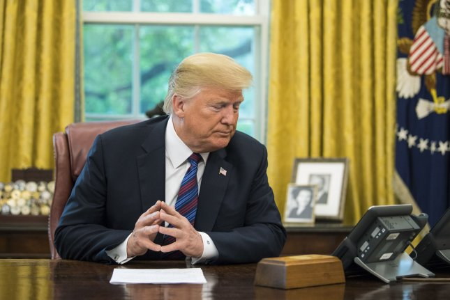 President Trump speaks on a conference call with Mexican President Enrique Pena Nieto, as Trump announces a revised trade deal with Mexico on August 27, 2018. The deal, if ratified by the United States, Mexico and Canada, will raise the price of new cars, analysts warned. Photo by Kevin Dietsch/UPI