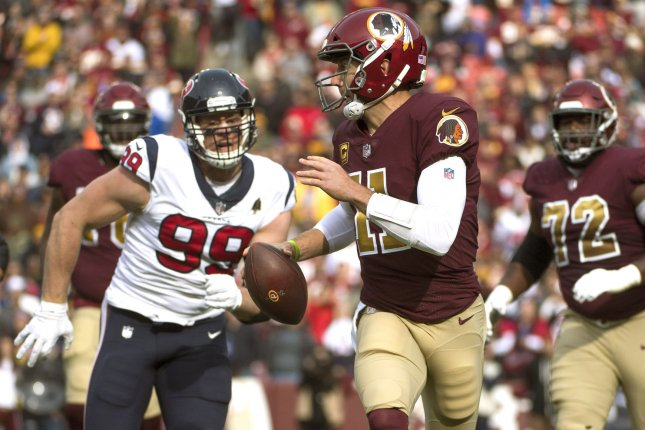 Washington Redskins quarterback Alex Smith (R) is set to make a base salary of $15 million in 2019, but is not expected to play this season after sustaining a broken leg in 2018. File Photo by Kevin Dietsch/UPI