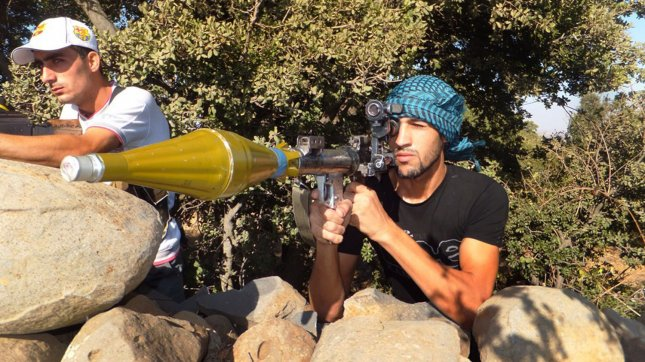Free Syrian Army soldier before firing a recoilless rifle during clashes with Syrian government forces at the suburbs of Damascus, Syria, August 13, 2012, government forces shelled a number of areas in northern Syria part of efforts by the regime to target rebel strongholds.Troops used planes to hit several homes in Aleppo, the Syrian Observatory for Human Rights. UPI