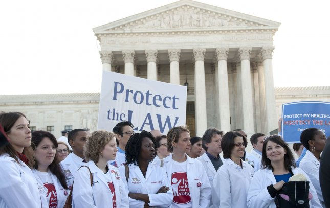 Doctors supporting the health care reform bill rally in front of the U.S. Supreme Court as the court begins hearing arguments on the constitutionality of President Obama's health care bill in Washington, D.C. on March 26, 2012. UPI/Kevin Dietsch