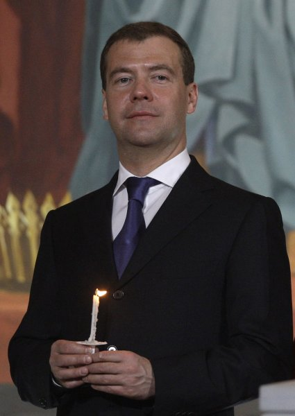 Russian President Dmitry Medvedev stands during night Easter service in the Christ the Savior Cathedral in Moscow on April 05, 2010. UPI Photo/Alex Natin.