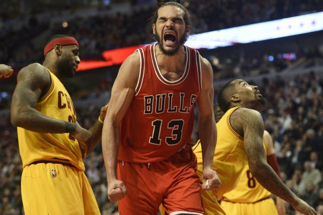 Chicago Bulls center Joakim Noah (C) reacts after he was fouled by Cleveland Cavaliers forward LeBron James (L) during the fourth quarter at the United Center on February 12, 2015 in Chicago. The Bulls defeated the Cavaliers 113-98. Photo by Brian Kersey/UPI