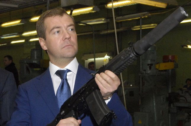 Russian Prime Minister Dmitry Medvedev seen in 2008 holding a Kalashnikov gun as he visits a plant manufacturing Kalashnikov assault rifles and other firearms in the central Russian city of Izhevsk, about 1000 kilometers (625 miles) east of Moscow, while serving as First Deputy Prime Minister. A U.S. company says it plans to start manufacturing Kalashnikov AK-47s in the United States after sanctions prevent the import of the gun. File photo by Mihail Kovalev/UPI