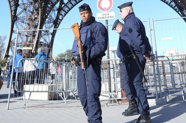Police patrol the Eiffel Tower in Paris, France on November 15, 2015. The United Nations Security Council on Friday unanimously approved a French resolution to use all necessary measures to fight the Islamic State terror group. The resolution allows nations to use military force against the group as long as it is in accordance with international and human rights laws. Photo by David Silpa/UPI