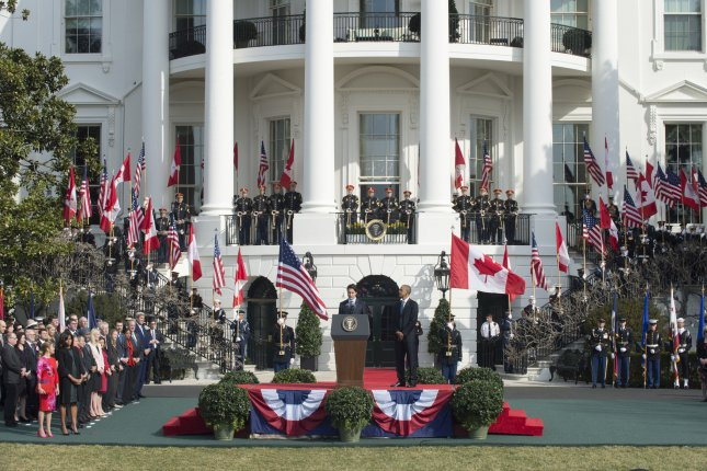U.S. President Barack Obama listens as Canadian Prime Minister Justin Trudeau makes his remarks during official welcoming ceremonies for the State Visit of the Canadian prime minister on the South Lawn of the White House in Washington, D.C., on March 10. Photo by Pat Benic/UPI