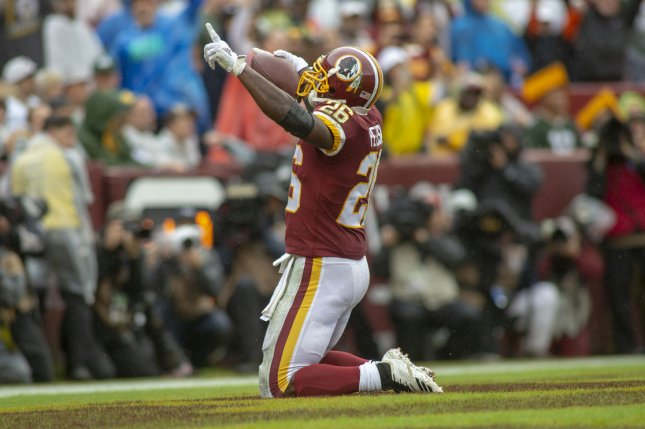 Washington Redskins running back Adrian Peterson celebrates in the end zone during a game against the Green Bay Packers at FedEx Field in Landover, Maryland on September 23, 2018. Photo by Alex Edelman/UPI