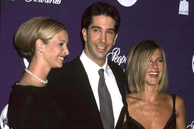 Lisa Kudrow (L), David Schwimmer and Jennifer Aniston attend the People's Choice Awards at the Pasadena Civic Auditorium January 7, 2001, in Pasadena, Calif. Friends debuted on NBC on September 22, 1994. File Photo by Russ Einhorn/UPI