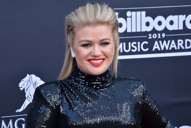Kelly Clarkson has announced a new holiday single titled Christmas Isn't Canceled (Just You). File Photo by Jim Ruymen/UPI