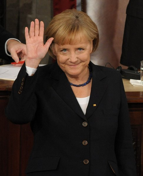 German Chancellor Angela Merkel waves before addressing a Joint Meeting of Congress on Capitol Hill in Washington on November 3, 2009. UPI/Roger L. Wollenberg