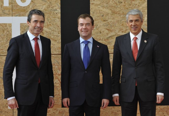 NATO Secretary General Anders Fogh (L), Russian President Dmitry Medvedev (C) and Portugal's Prime Minister Jose Socrates pose before NATO Russia Council meeting during NATO summit in Lisbon on November 20, 2010.. UPI