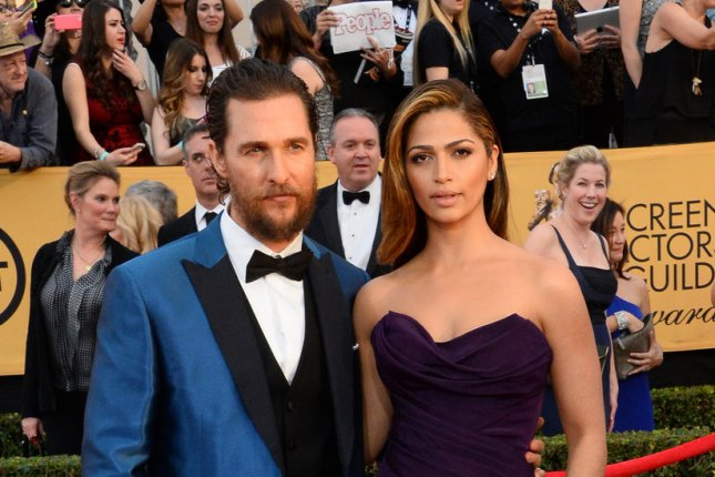 Matthew McConaughey (L) and wife Camila Alves at the SAG Awards on January 25. The model acquired her U.S. citizenship Tuesday. File photo by Jim Ruymen/UPI