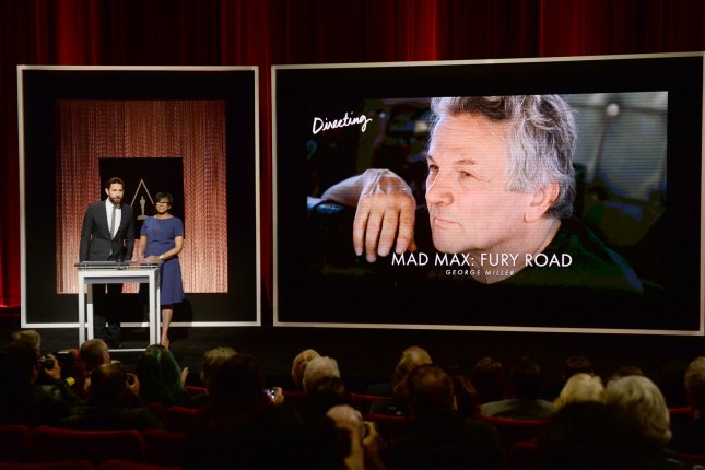 Actor John Krasinski (L) and Academy President Cheryl Boone Isaacs announce George Miller as a nominee for Best Director for Mad Max: Fury Road at the Samuel Goldwyn Theatre in Beverly Hills on January 14, 2016. Photo by Jim Ruymen/UPI