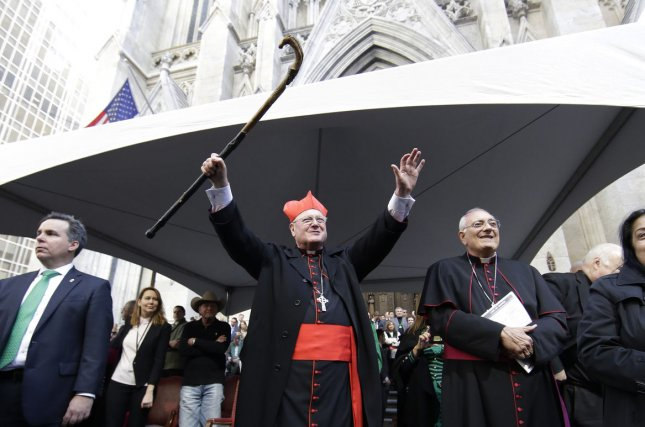 Cardinal Timothy Dolan greets people on the parade route at the St. Patrick's Day Parade on Fifth Avenue in New York. Dolan sat between Hillary Clinton and Donald Trump at Thursday's Al Smith Dinner and said the two candidates made a genuine effort to be courteous despite the rough campaign. File Photo by John Angelillo/UPI