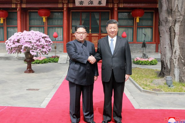 Chinese President Xi Jinping (R) could meet again with Kim Jong Un in July, according to human rights activists in Hong Kong. Photo by KCNA/UPI
