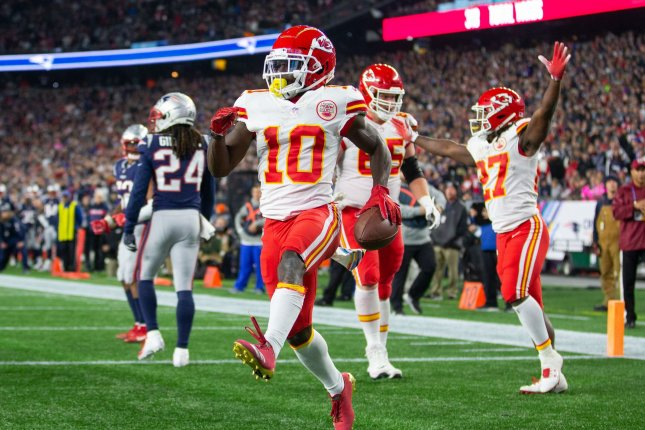 Kansas City Chiefs wide receiver Tyreek Hill (10) celebrates his one-yard touchdown reception in the fourth quarter against the New England Patriots on Sunday at Gillette Stadium in Foxborough, Mass. Photo by Matthew Healey/UPI