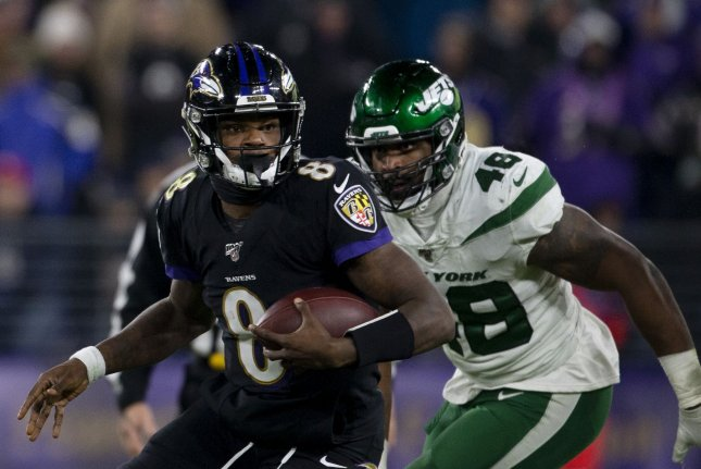 Baltimore Ravens quarterback Lamar Jackson (8) set an NFL record for the most rushing yards in a single season for a quarterback in a win against the New York Jets Thursday in Baltimore. Photo by Tasos Katopodis/UPI