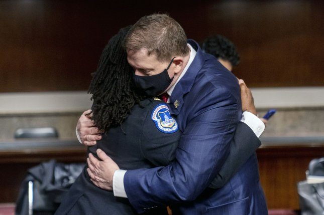 Former U.S. Capitol Police Chief Steven Sund hugs Capitol Police Captain Carneysha Mendoza before they testify on Tuesday before a joint Senate homeland security and rules committee hearing on Capitol Hill, in Washington, D.C. Photo by Andrew Harnik/UPI/Pool