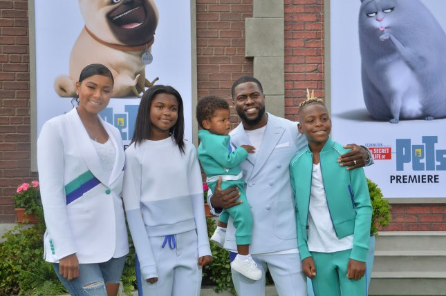 Kevin Hart (second from right), pictured with Eniko Parrish, daughter Heaven and sons Kenzo and Hendrix, from left to right, discussed his bond with his family on The Tonight Show starring Jimmy Fallon after welcoming his fourth child, daughter Kaori. File Photo by Jim Ruymen/UPI