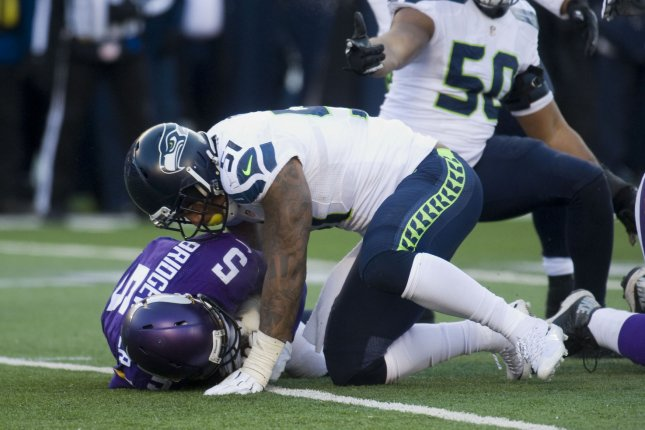 Minnesota Vikings quarterback Teddy Bridgewater (5) is sacked in the fourth quarter against the Seattle Seahawks. The Vikings must look to upgrade an offensive line shattered by injuries in 2016. Photo by Marilyn Indahl/UPI
