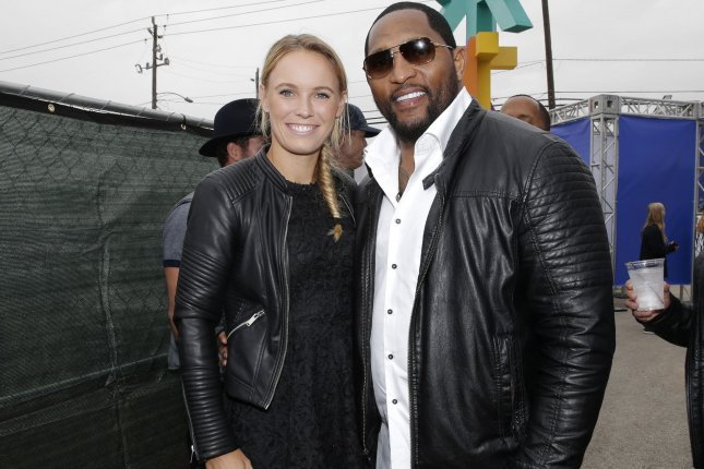 Caroline Wozniacki and Ray Lewis arrive at the Wheels Up Super Saturday Tailgate event on the eve of Super Bowl LI on February 4 in Houston, Texas. File photo by John Angelillo/UPI