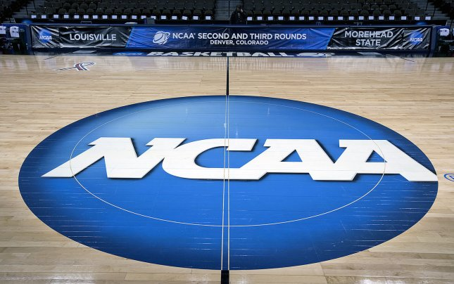 Two Adidas officials and a sports agent were sentenced to between six and nine months in prison for brokering deals to send college basketball prospects to universities sponsored by the company. File Photo by Gary C. Caskey/UPI