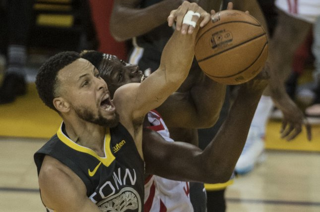 9004bba9f5ca Golden State Warriors guard Stephen Curry (30) blocks a shot by Houston  Rockets center Clint Capela (15) in the first half of Game 2 of the Western  ...