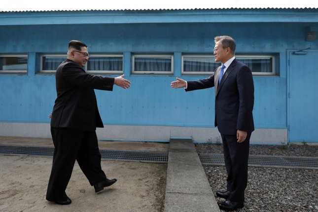 South Korean President Moon Jae-in (R) and North Korean Chairman Kim Jong Un meet in April 2018. Frustrated conservatives in the South have previously berated Moon for meeting Kim. File Photo by Inter-Korean Summit Press Corps/UPI