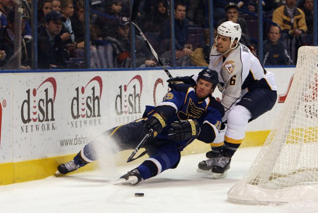 Nashville Predators Shea Weber (6) pulls down St. Louis Blues Brad Winchester behind the net during the first period at the Scottrade Center in St. Louis, Dec. 29, 2009. UPI/Bill Greenblatt