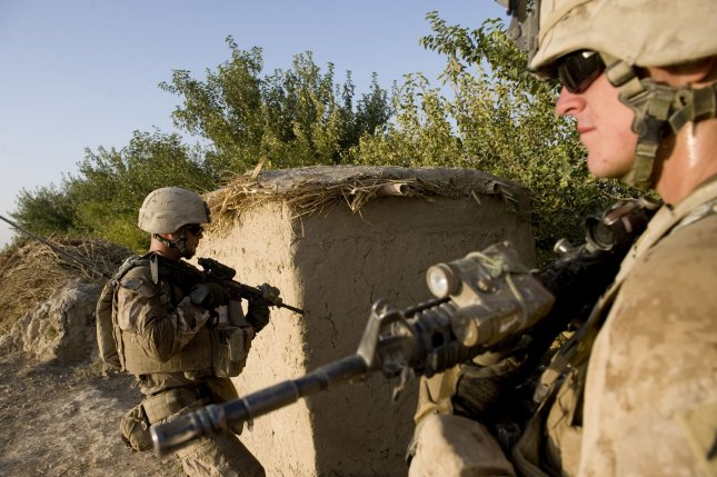 U.S. Marines participates in a security patrol in Gorgak district of Helmand province of Afghanistan on August 25, 2010. Military leaders have expressed concern that the recent debt bill in Washington may have severe cuts in defense spending. UPI/Hossein Fatemi