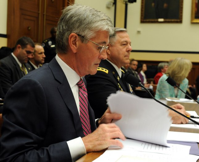 John McHugh, Secretary of the Army, seen here giving testimony to the House Armed Services Committee, agreed to postpone the discharge of Sgt. First Class Chris Martland. File photo by Roger L. Wollenberg/UPI