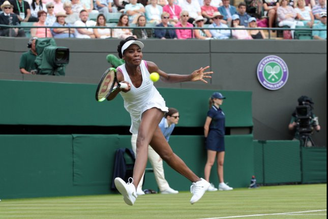 Venus Williams plays a forehand in her match against Belgium's Elise Mertens at the 2017 Wimbledon championships in London. Photo by Hugo Philpott/UPI