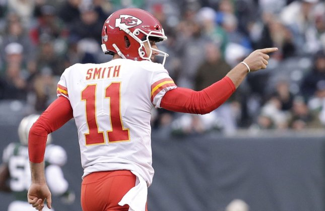 Former Kansas City Chiefs quarterback Alex Smith reacts after throwing a touchdown pass against the New York Jets on Dec. 3. Photo by John Angelillo/UPI