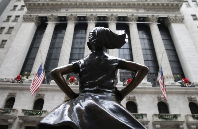 The Fearless Girl statue stands in its new location outside of the NYSE after the opening bell at the New York Stock Exchange on Wall Street in New York City. The Dow Jones Industrial Average bounced back from down as much as 600 points to close 260 points Thursday. Photo by John Angelillo/UPI