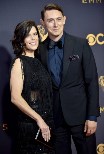 Actor JJ Feild -- seen here with his wife Neve Campbell -- has joined the cast of Lost in Space for Season 2. File Photo by Christine Chew/UPI