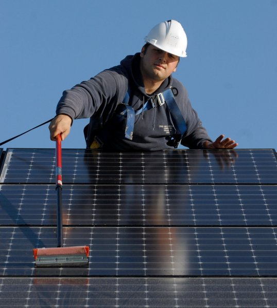 Increased investment in solar energy (solar panels shown) while reducing fossil fuel use is part of the International Energy Agency's roadmap to net zero emissions by 2050, a special report released Tuesday shows. File Photo by Roger L. Wollenberg/UPI